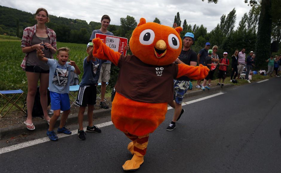 Supporters cheer the riders during the tenth stage of the Tour de France cycling race over 178 kilometers (110.6 miles) with start in Perigueux and finish in Bergerac, France. AP