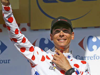 Stage winner France's Warren Barguil, wearing the best climber's dotted jersey, celebrates on the podium after the eighteenth stage of the Tour de France cycling race over 179.5 kilometers (111.5 miles) with start in Briancon and finish on Izoard pass, France, Thursday, July 20, 2017. (AP Photo/Peter Dejong)