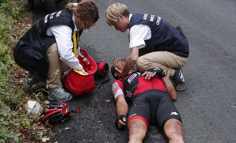 Australia's Richie Porte gets medical assistance after crashing in the descent of the Mont du Chat pass during the ninth stage of the Tour de France cycling race over 181.5 kilometers (112.8 miles) with start in Nantua and finish in Chambery, France, Sunday, July 9, 2017. (AP Photo/Christophe Ena)