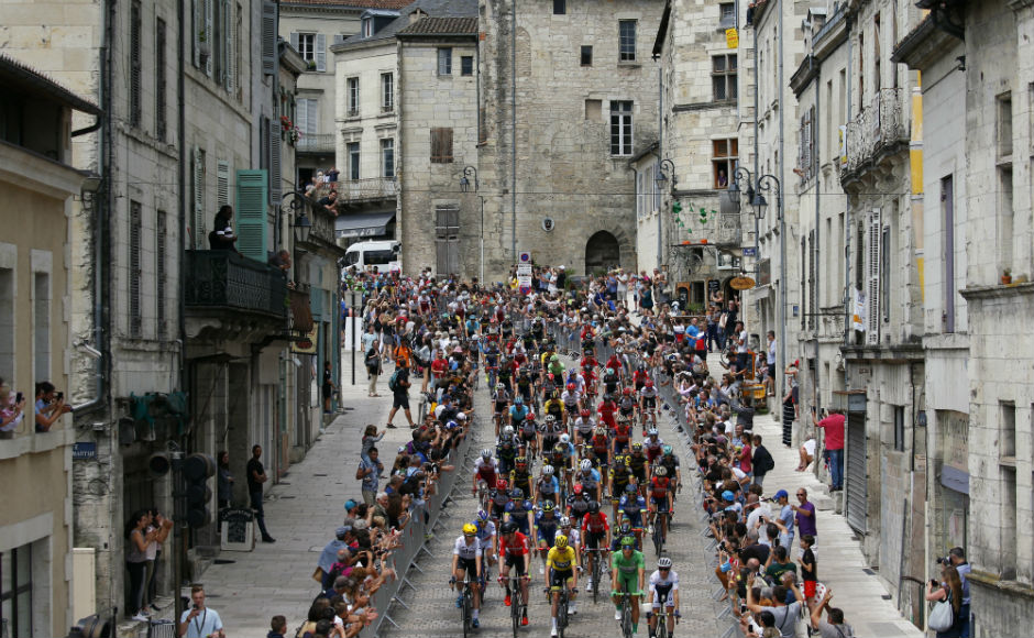 The pack rides in Perigueux during the tenth stage of the Tour de France cycling race over 178 kilometers (110.6 miles) with start in Perigueux and finish in Bergerac. AP