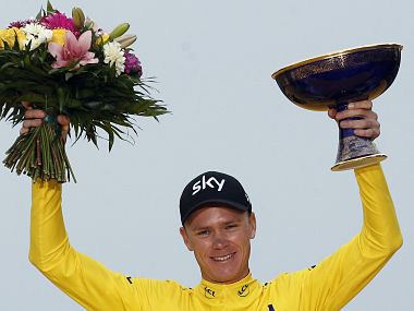 Tour de France winner Britain's Chris Froome, wearing the overall leader's yellow jersey, celebrates on the podium after the twenty-first and last stage of the Tour de France cycling race over 103 kilometers (64 miles) with start in Montgeron and finish in Paris, France, Sunday, July 23, 2017. Froome won his fourth and most challenging Tour de France title on Sunday. (AP Photo/Thibault Camus)