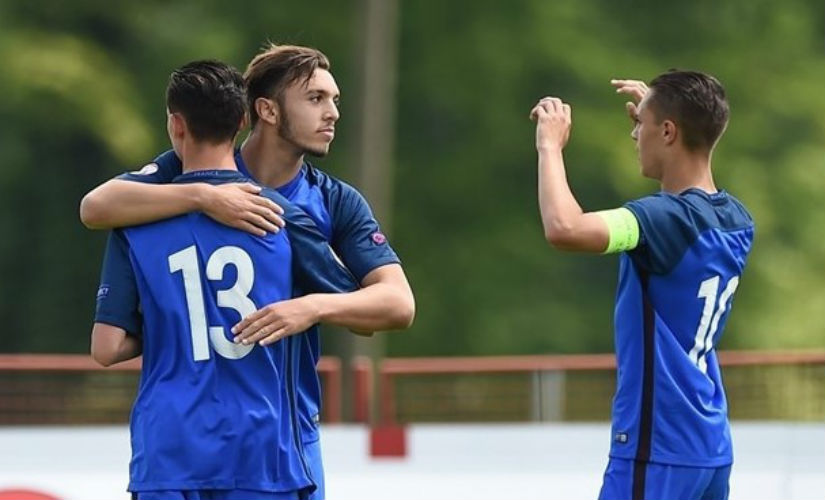 Amine Gouiri of France (second left) celebrates with teammates after scoring his side's first goal during their FIFA U-17 World Cup play-off match. UEFA