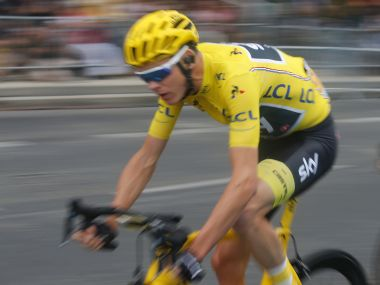 Britain's Chris Froome, wearing the overall leader's yellow jersey, rides during the twenty-first and last stage of the Tour de France cycling race over 103 kilometers (64 miles) with start in Montgeron and finish in Paris, France, Sunday, July 23, 2017. (AP Photo/Laurent Rebours)