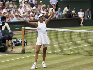 Garbine Muguruza celebrates after beating Magdalena Rybarikova in their semi-final. AP