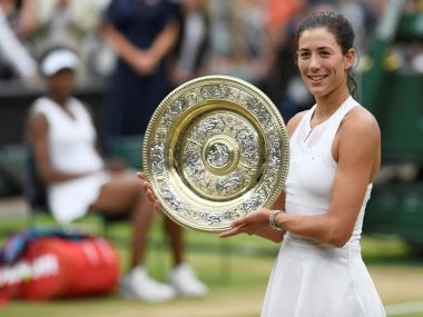Garbine Muguruza poses with the trophy as she celebrates winning the Wimbledon final against Venus Williams. Reuters