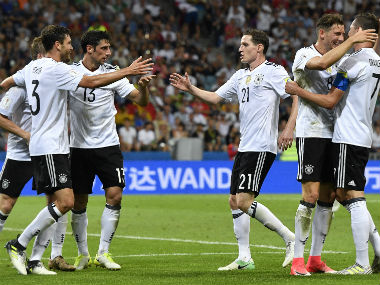 Germany players celebrate their third goal against Mexico in the semi-finals. AP