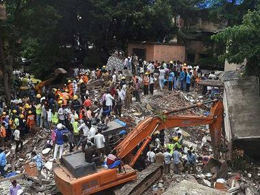 A four-storey residential building collapsed in suburban Ghatkopar in Mumbai on Tuesday. PTI