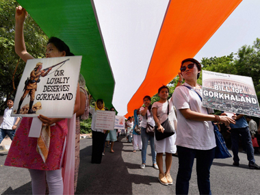 Members of People's Movement for Gorkhaland carry a 110 mt-long Tri-Colour during a peace march from Rajghat to Jantar Mantar in demand for separate Gorkhanland, in New Delhi on Sunday. PTI