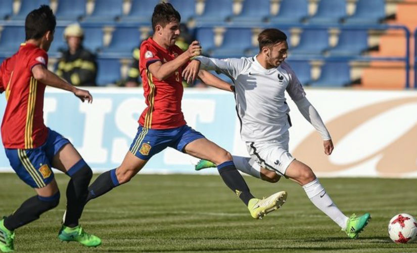 Amine Gouiri of France (R) shoots to score his side's first goal during their UEFA European Under-17 Championship quarter-final match. UEFA