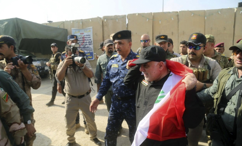 Haider al-Abadi congratulates his troops. AP