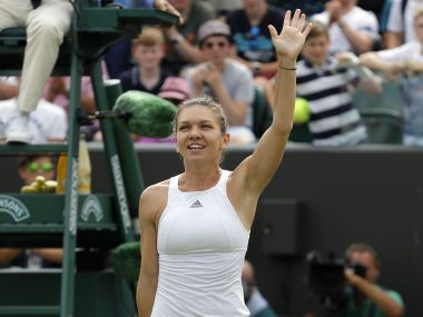 Romania's Simona Halep celebrates after beating Victoria Azarenka of Belarus in their Women's Singles Match on day seven at the Wimbledon Tennis Championships in London Monday, July 10, 2017. (AP Photo/Alastair Grant)