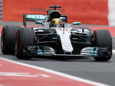 Mercedes driver Lewis Hamilton of Britain steers his car on the pit lane during the third free practice session for the British Formula One Grand Prix at the Silverstone racetrack in Silverstone, England, Saturday, July 15, 2017. The British Formula One Grand Prix will be held on Sunday, July 16. (AP Photo/Frank Augstein)