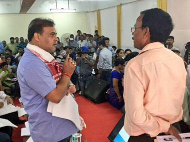 Assam education minister Himanta Biswa Sarma talking to one of the participants in the review meeting on Monday. Image courtesy Sarma's Facebook page