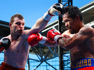 Manny Pacquiao (R) of the Philippines fight Jeff Horn (L) of Australia during the World Boxing Organization boat at Suncorp Stadium in Brisbane on July 1, 2017. / AFP PHOTO / Patrick HAMILTON / -- IMAGE RESTRICTED TO EDITORIAL USE - STRICTLY NO COMMERCIAL USE --