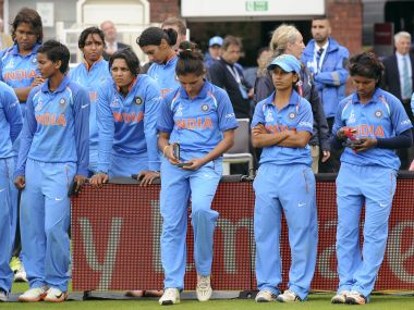 India's players stand dejected after losing the Women's World Cup final at Lord's, on Sunday. AP Photo