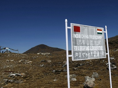 A signboard is seen from the Indian side of the Indo-China border. Reuters