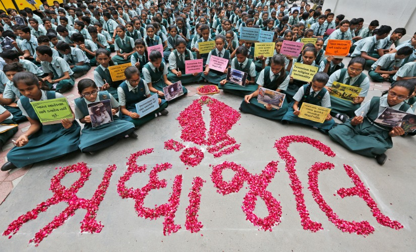 Indian students holds placards in Ahmadabad. AP