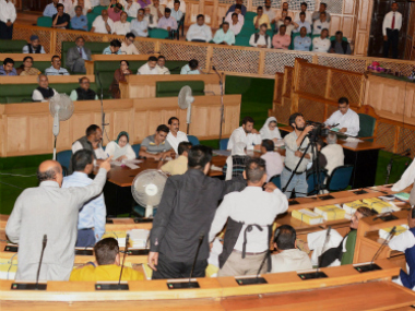 National Conference and Congress MLA's shout slogans Legislative Assembly in Srinagar on Tuesday. PTI