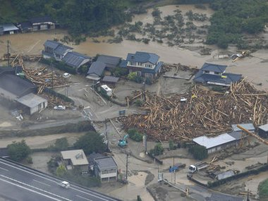 This aerial photo shows a flooded area in Asakura, Fukuoka prefecture, southwestern Japan Thursday. AP
