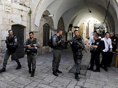 Israeli border policemen secure the area near the scene of the shooting attack in Jerusalem. Reuters
