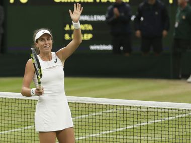 Johanna Konta celebrates after beating Simona Halep at Wimbledon. AP