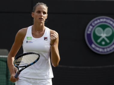 Czech Republic's Karolina Pliskova celebrates after winning her Women's Singles Match against Russia's Evgeniya Rodina on day two at the Wimbledon Tennis Championships in London Tuesday, July 4, 2017. (AP Photo/Kirsty Wigglesworth)