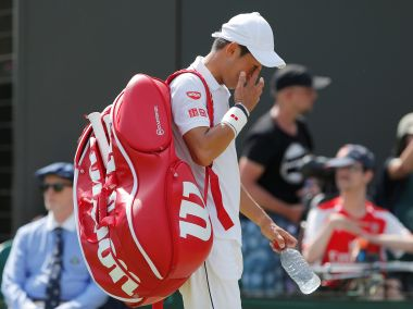 Tennis - Wimbledon - London, Britain - July 7, 2017 Japan's Kei Nishikori reacts after losing his third round match against Spain's Roberto Bautista Agut REUTERS/Andrew Couldridge - RTX3AI2D