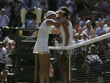 Britain's Johanna Konta, right, hugs Croatia's Donna Vekic after winning their Women's Singles Match on day three at the Wimbledon Tennis Championships in London Wednesday, July 5, 2017. (AP Photo/Tim Ireland)