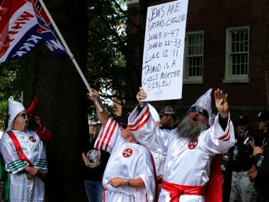 Ku Klux Klan supporters march in Charlottesville. Reuters