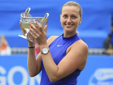 Czech Republic's Petra Kvitova celebrates with the trophy after winning the final match at the Birmingham Classic tennis tournament against Australia's Ashleigh Barty at Edgbaston Priory, Birmingham, England, Sunday June 25, 2017. (Mike Egerton/PA via AP)