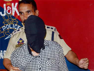 Police arrests Lashkar-e-Taiba militant Sandeep Kumar Sharma, resident of Uttar Pradesh, from the same house where LeT commander Bashir Lashkari was killed on July 1, at a press conference in Srinagar on Monday. PTI