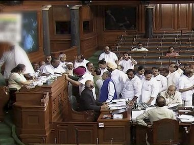 Opposition congress members protest in the well of Lok Sabha in New Delhi on Monday. PTI