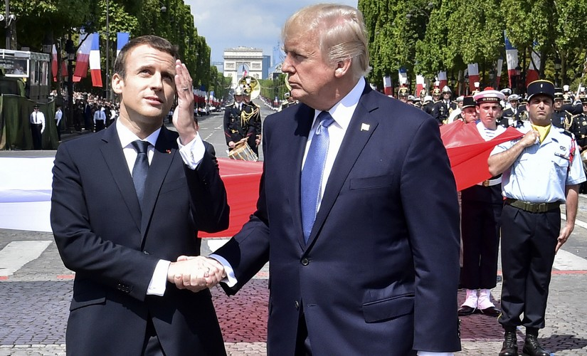 France president Emmanuel Macron with US president Donald Trump in their 25-second handshake. AP