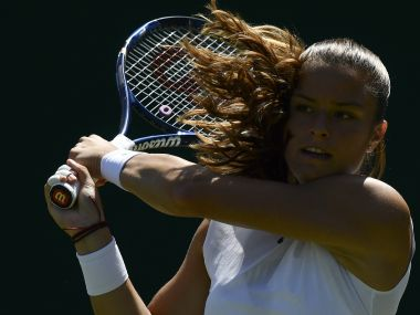 Greece's Maria Sakkari returns against Czech Republic's Kristyna Pliskova during their women's singles second round match on the third day of the 2017 Wimbledon Championships at The All England Lawn Tennis Club in Wimbledon, southwest London, on July 5, 2017. / AFP PHOTO / Justin TALLIS / RESTRICTED TO EDITORIAL USE