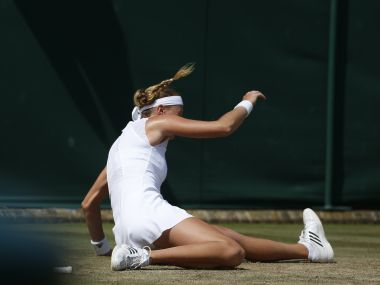 Kristina Mladenovic of France slips over during her Women's Singles Match against Alison Riske of the United States on day four at the Wimbledon Tennis Championships in London Thursday, July 6, 2017. (AP Photo/Alastair Grant)