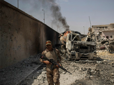 An Iraqi army soldier walks on a damaged street as Iraqi forces continue their advance against Islamic State militants in the Old City of Mosul, Iraq, on Saturday. AP