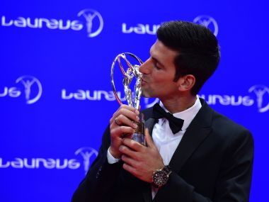 Novak Djokovic with his Laureus World Sportsman of the Year trophy in 2016. AFP