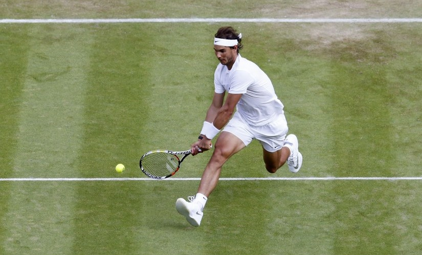 Rafael Nadal recently won his 10th French Open title but will need to produce an extraordinary effort to lift his third Wimbledon title. Reuters
