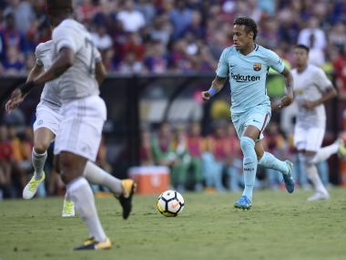 Neymar of Barcelona controls the ball during their International Champions Cup (ICC) football match against Manchester United on July 26, 2017 at the FedExField, in Landover, Maryland. / AFP PHOTO / Brendan Smialowski