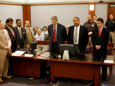 "FILE - In this Oct. 3, 2008 file photo, co-defendants Clarence ""C.J."" Stewart, second from left, and O. J. Simpson, second from right, and their defense teams listen as the two are found guilty on 12 charges. (AP Photo/Daniel Gluskoter, Pool, file)"