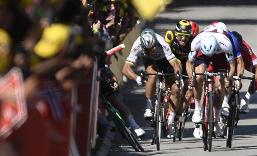 Peter Sagan (second from left) elbows Mark Cavendish (left) on Tuesday. AFP