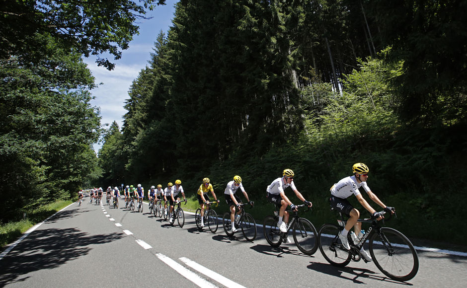 The pack with team Sky and Britain's Geraint Thomas wearing the overall leader's yellow jersey rides during the third stage of the Tour de France cycling race over 212.5 kilometers with start in Verviers Belgium and finish in Longwy France