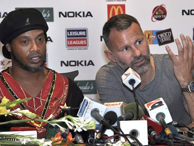 Manchester United legend Ryan Giggs speaks next to Brazilian soccer star Ronaldinho during a press conference in Lahore on Sunday.