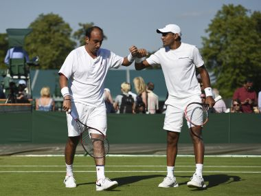 India's Purav Raja (L) and Divij Sharan (R) touch hands between points during their men's doubles first round match against Britain's Kyle Edmund and Brazil's Joao Sousa on the third day of the 2017 Wimbledon Championships at The All England Lawn Tennis Club in Wimbledon, southwest London, on July 5, 2017. / AFP PHOTO / Oli SCARFF / RESTRICTED TO EDITORIAL USE