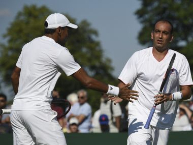 India's Purav Raja (R) and Divij Sharan (L) touch hands between points during their men's doubles first round match against Britain's Kyle Edmund and Brazil's Joao Sousa on the third day of the 2017 Wimbledon Championships at The All England Lawn Tennis Club in Wimbledon, southwest London, on July 5, 2017. / AFP PHOTO / Oli SCARFF / RESTRICTED TO EDITORIAL USE