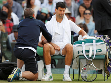 Tennis - Wimbledon - London, Britain - July 12, 2017 Serbia's Novak Djokovic receives medical attention during his quarter final match against Czech Republic's Tomas Berdych REUTERS/Matthew Childs - RTX3B6H7