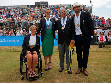 The 2017 inductees into the International Tennis Hall of Fame (L-R) Monique Kalkman van den Bosch of the Netherlands, Kim Clijsters of Belgium, journalist Steve Flink of the U.S. and Andy Roddick of the U.S pose for photographs after ceremonies in Newport, Rhode Island, U.S., July 22, 2017. REUTERS/Brian Snyder TPX IMAGES OF THE DAY - RTX3CJ6Y