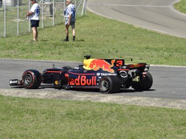 The crashed car of Australian Formula One driver Daniel Ricciardo of Red Bull Racing is seen just moments after the start of the Formula One Hungarian Grand Prix on the Hungaroring circuit in Mogyorod, 23 kms north-east of Budapest, Hungary, Sunday, July 30, 2017. (Zoltan Mathe/MTI via AP)