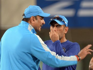 Mahendra Singh Dhoni (right) talks with Ravi Shastri during a training session in February 2016. AFP