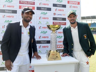 Sri Lanka captain Dinesh Chandimal (L) and Zimbabwe captain Graeme Cremer (R). AFP